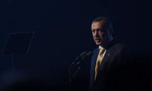 Turkish PM Erdogan addresses the audience during a ceremony at the Turkish Aerospace Industries in Ankara