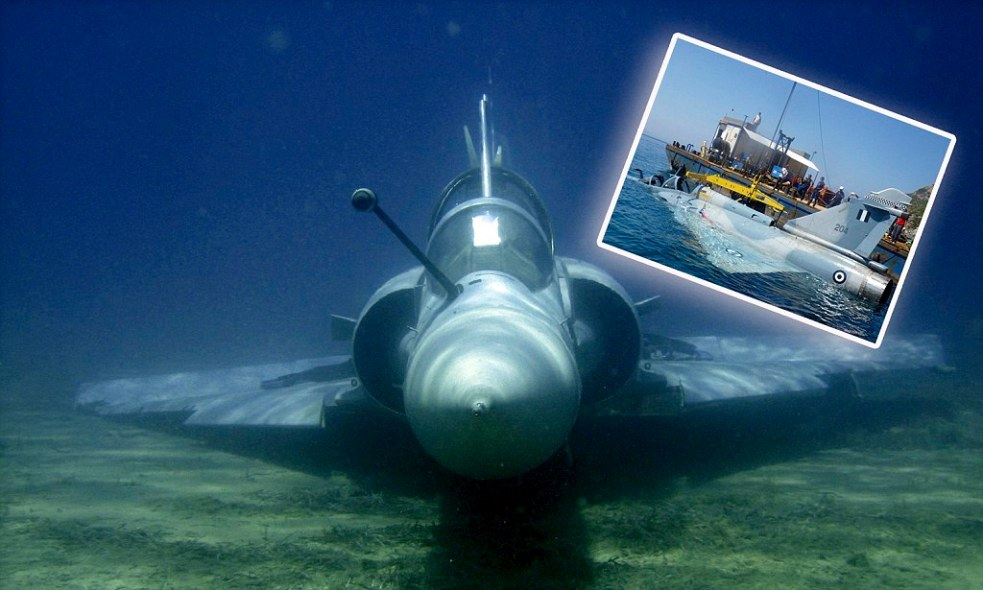 A handout photo taken June 21, 2011 shows a Greek Air Force Mirage 2000 jet fighter lying in the bottom of the Aegean sea near the Greek island of Samos after it crashed on June 9, 2011. Both pilots ejected before the crash and were rescued unhurt by a military vessel, Greek military officials said. Photo taken June 21, 2011. REUTERS/Greek Air Force/Handout (GREECE - Tags: DISASTER MILITARY IMAGES OF THE DAY) NO SALES. NO ARCHIVES. FOR EDITORIAL USE ONLY. NOT FOR SALE FOR MARKETING OR ADVERTISING CAMPAIGNS. THIS IMAGE HAS BEEN SUPPLIED BY A THIRD PARTY. IT IS DISTRIBUTED, EXACTLY AS RECEIVED BY REUTERS, AS A SERVICE TO CLIENTS